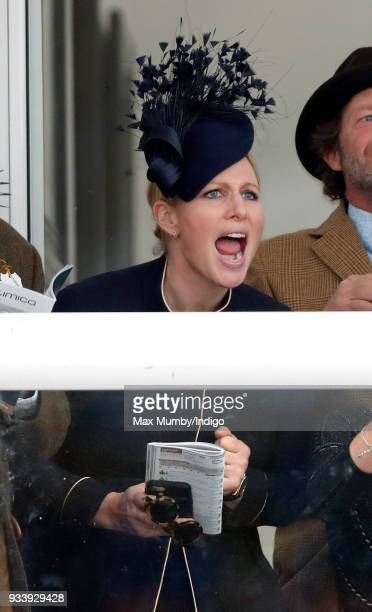 Zara Phillips watches the racing as she attends day 4 'Gold Cup Day' of the Cheltenham Festival at Cheltenham Racecourse on March 16 2018 in...