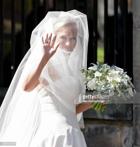 Zara Phillips waves as she arrives at Canongate Kirk for her wedding to Mike Tindall on July 30, 2011 in Edinburgh, Scotland. The Queen's...