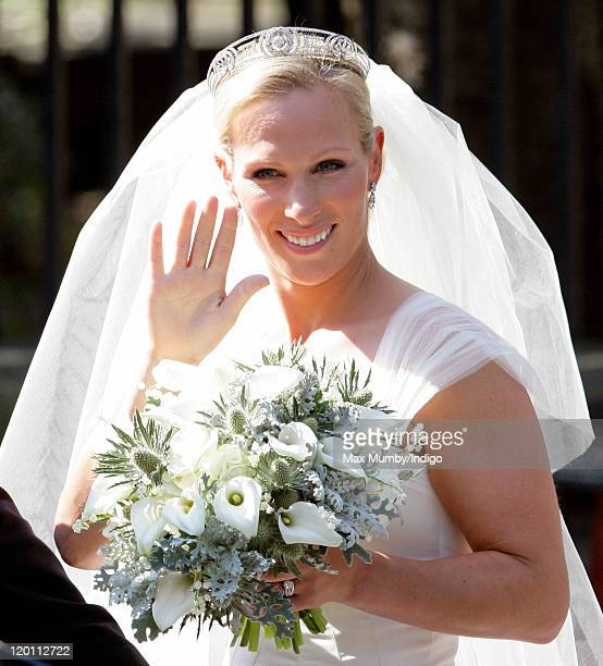 Zara Phillips waves to the crowds as she leaves Canongate Kirk after her wedding to Mike Tindall on July 30, 2011 in Edinburgh, Scotland. The Queen's...
