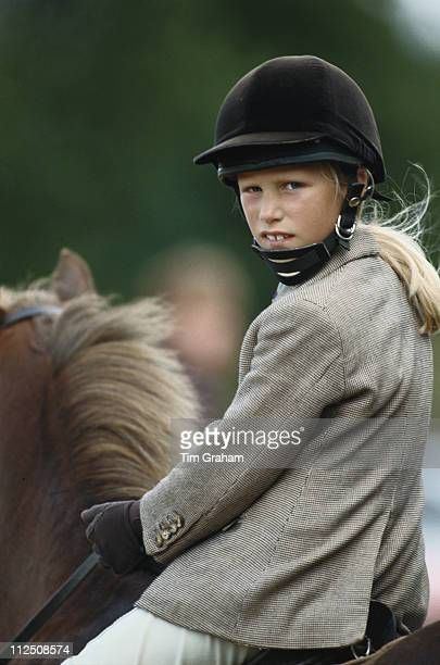 Zara Phillips wearing a tweed riding jacket and riding helmet riding a pony at Dauntsey Horse Trials in Dauntsey Wiltshire England Great Britain 31...