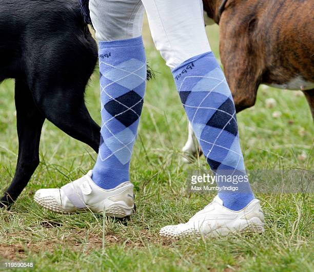 Zara Phillips wears Argyle socks as she walks her dogs around the cross country course during a break from competing in the AstonleWalls Horse Trials...
