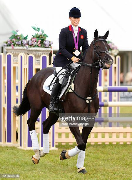 Zara Phillips wears her London 2012 Olympic silver medal as she and her fellow team eventing medal winners parade at the Blenheim Palace...