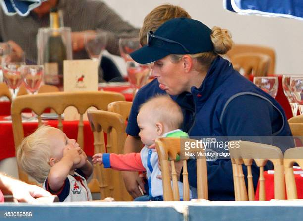 Zara Phillips with daughter Mia Tindall jokes with her niece Isla Phillips as she attends day 2 of the Festival of British Eventing at Gatcombe Park...