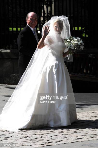 Zara Phillips with her father Captain Mark Phillips arrives at Canongate Kirk on Edinburgh's Royal Mile in her wedding dress and veil for her...