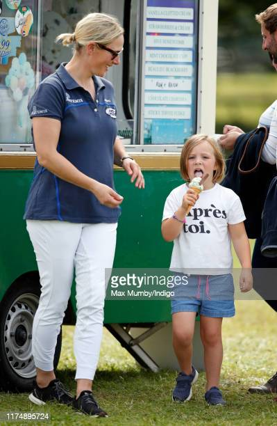Zara Tindall and Mia Tindall queue to buy an ice cream as they attend day 3 of the Whatley Manor Gatcombe International Horse Trials at Gatcombe Park...