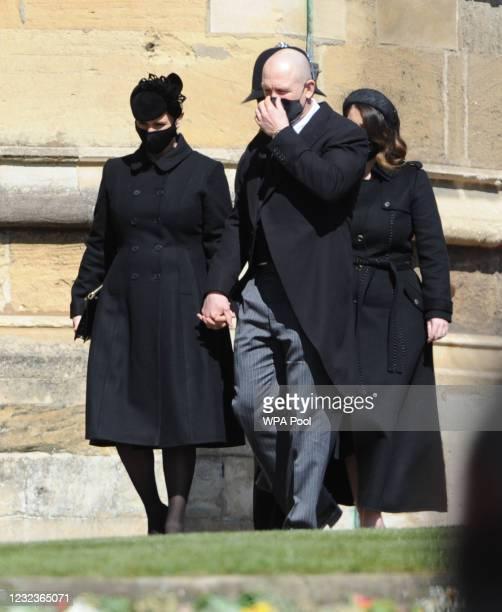 Zara Tindall and Mike Tindall arrive for Prince Philip, Duke of Edinburgh's funeral at Windsor Castle on April 17, 2021 in Windsor, United Kingdom....