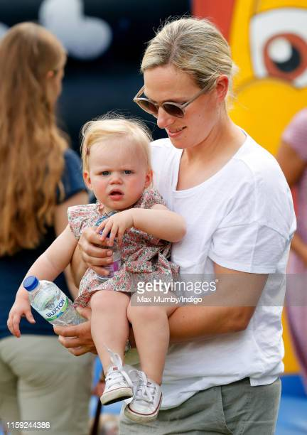 Zara Tindall carries daughter Lena Tindall as they attend day 1 of the 2019 Festival of British Eventing at Gatcombe Park on August 2, 2019 in...