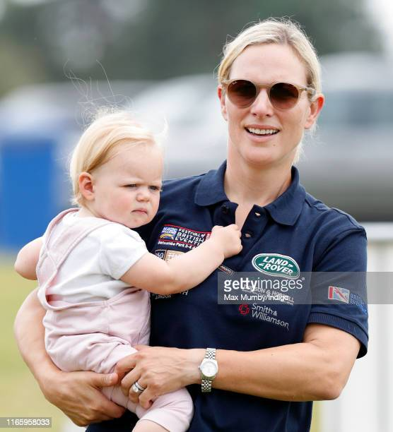 Zara Tindall carries daughter Lena Tindall as they attend day 2 of the 2019 Festival of British Eventing at Gatcombe Park on August 3, 2019 in...