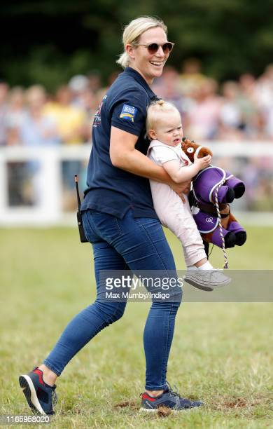 Zara Tindall carries daughter Lena Tindall on day 2 of the 2019 Festival of British Eventing at Gatcombe Park on August 3, 2019 in Stroud, England.