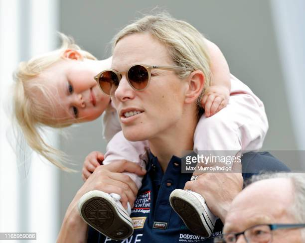 Zara Tindall carries daughter Lena Tindall on her shoulders as they attend day 2 of the 2019 Festival of British Eventing at Gatcombe Park on August...