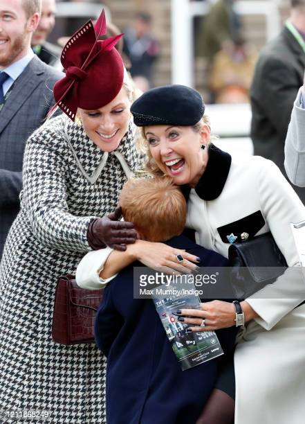 Zara Tindall Chanelle McCoy and Archie McCoy attend day 2 'Ladies Day' of the Cheltenham Festival 2020 at Cheltenham Racecourse on March 11 2020 in...