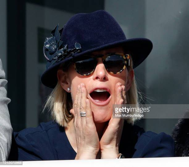 Zara Tindall cheers as she watches the racing on day 3 'St Patrick's Thursday' of the Cheltenham Festival 2020 at Cheltenham Racecourse on March 12...