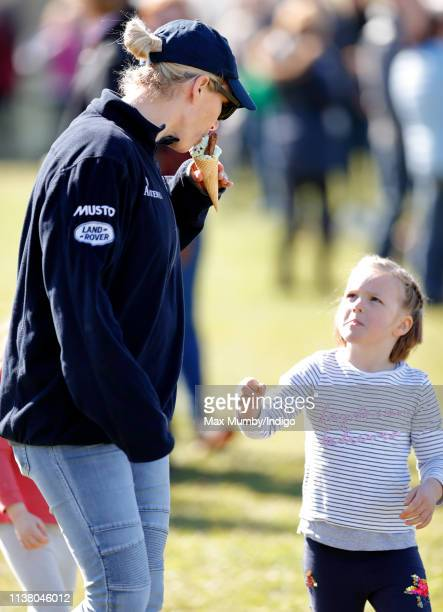 Zara Tindall eats some of daughter Mia Tindall's ice cream as they attend the Gatcombe Horse Trials at Gatcombe Park on March 24 2019 in Stroud...