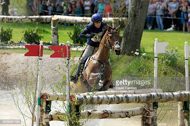 Zara Tindall of Great Britain riding High Kingdom rides through the 'Gatehouse New Pond' during the cross-country test on day four of the Badminton...