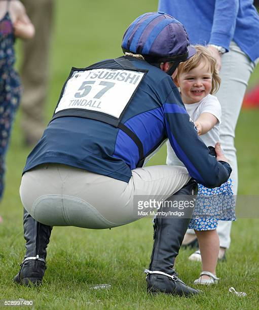 Zara Tindall picks up daughter Mia Tindall after competing in the cross country phase of the Badminton Horse Trials on May 7 2016 in Badminton England