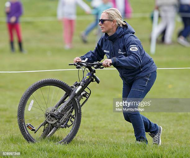 Zara Tindall rides her pushbike around the Badminton Horse Trials before competing in the cross country phase of the event on May 7 2016 in Badminton...
