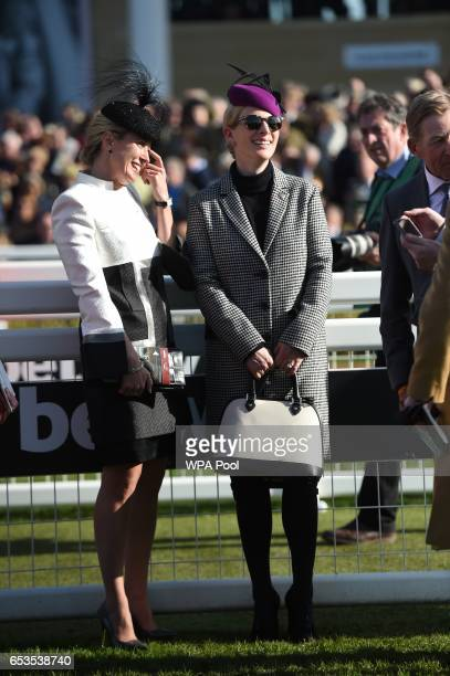 Zara Tindall speaks with Chanelle McCoy as they attend the second day of The Festival Ladies Day at Cheltenham Racecourse on March 15 2017 in...