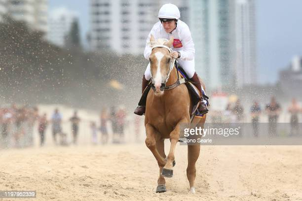 Zara Tindall, the eldest granddaughter of Queen Elizabeth II, rides a horse on Surfers Paradise beach during the 2020 Magic Millions official draw at...