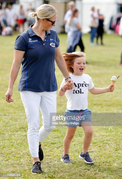 Zara Tindall walks hand in hand with daughter Mia Tindall as they attend day 3 of the Whatley Manor Gatcombe International Horse Trials at Gatcombe...
