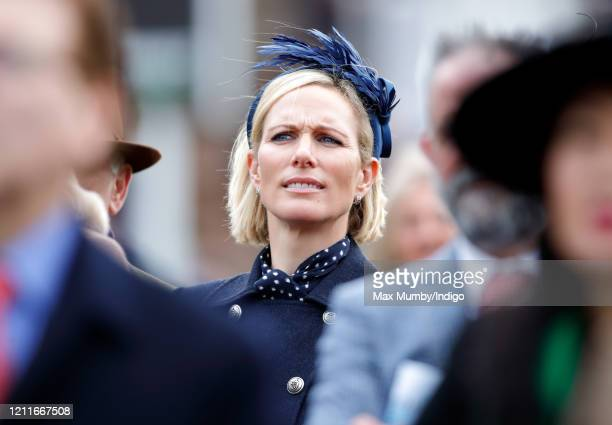 Zara Tindall watches the racing as she attends day 1 'Champion Day' of the Cheltenham Festival 2020 at Cheltenham Racecourse on March 10 2020 in...