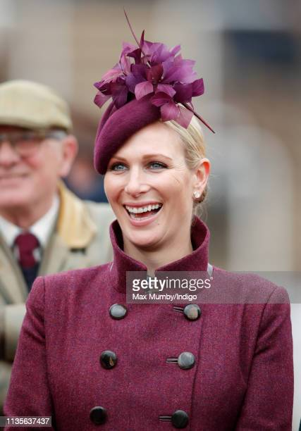Zara Tindall watches the racing as she attends day 2 'Ladies Day' of the Cheltenham Festival at Cheltenham Racecourse on March 13 2019 in Cheltenham...