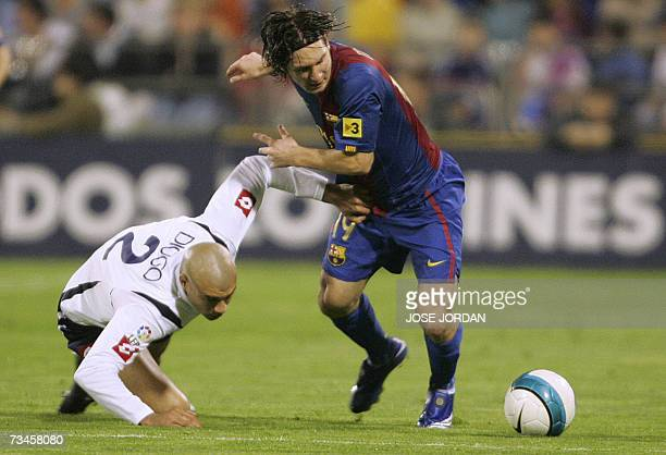 Barcelonas Argenti nian Lionelm Messi vies for the ball with Uruguayan Carlos Diogo during their Spanish King Cup football match at Romareda Satdium...