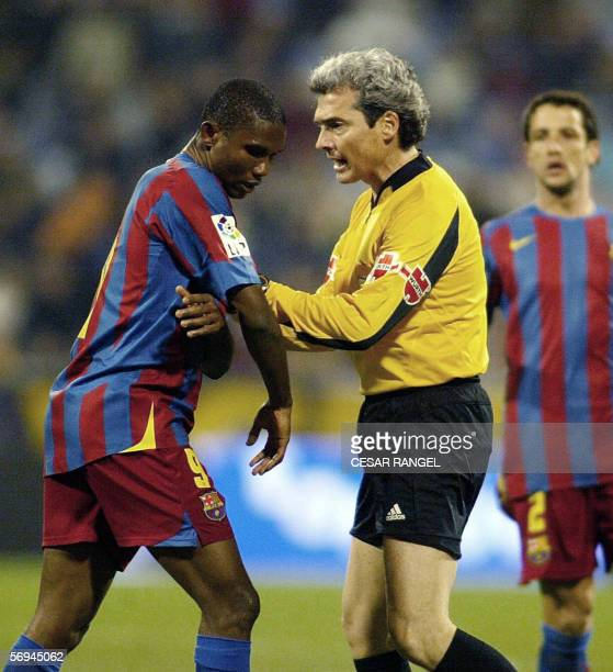 Barcelona's Samuel Eto of Cameroon argues with the referee as he wants to leave the field after racist insults of the crowd during the match against...