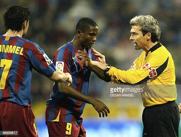 Barcelona's Samuel Eto of Cameroon argues with the referee Esquinas Torres after he suffered racist insults from the crowd during their soccer First...