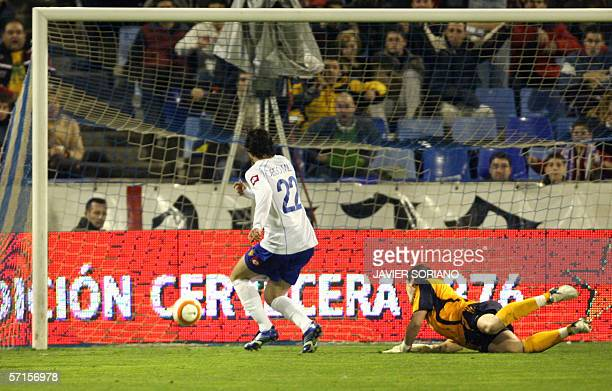Zaragoza Diego Milito shoots to score in front of Real Madrid's goalkeeper Iker Casillas during their Spanish league football match at La Romareda...