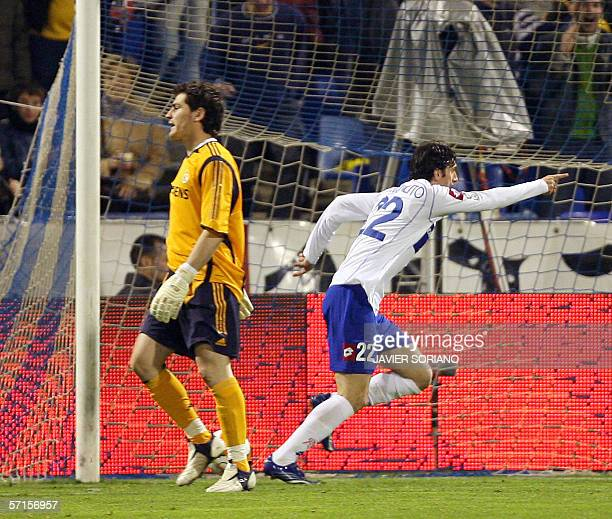 Zaragoza's Aregntinean defender Diego Milito celebrates after opening the score against Real Madrid's Spanish goalkeeper Iker Casillas during their...