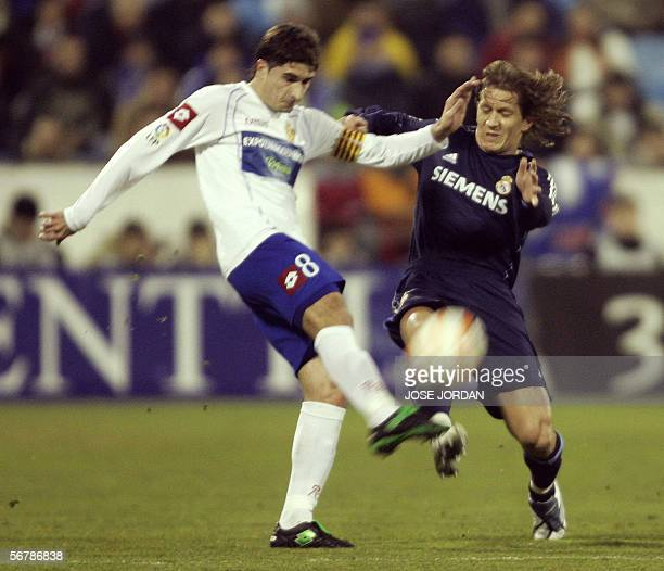 Zaragoza's Ruben Cani fights for the ball with Real Madrid 's Michel Salgado during their Spanish King Cup first semifinal football match at Rosareda...