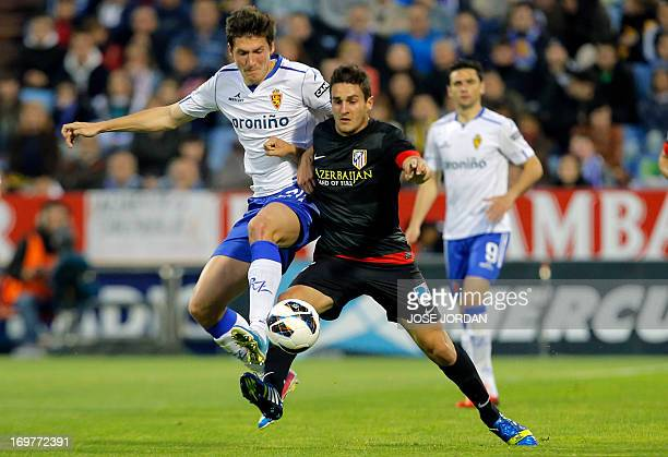Zaragoza's Dutch defender Glenn Loovens vies for the ball with Atletico Madrid's midfielder Koke during the Spanish league football match Real...