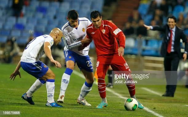 Zaragoza's forward Javier Alamo and Zaragoza's midfielder Jose Maria Movilla vies with Sevilla's forward Jose Antonio Reyes during the Spanish Copa...