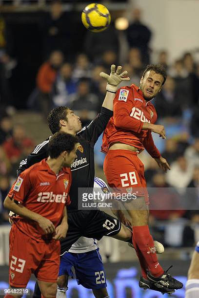 Zaragoza's goalkeeper Javier Lopez Vallejo jumps for the ball with Juan Cala during the Spanish League football match on February 7 2010 at La...