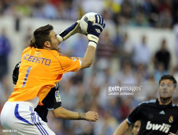 Zaragoza's goalkeeper Roberto fights for the ball against Real Madrid's midfielder Xabi Alonso during the Spanish League football match Zaragoza...
