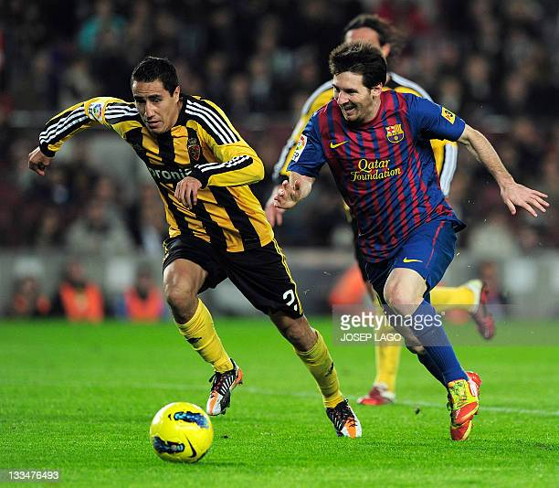 Zaragoza's Mexican defender Efrain Juarez Valdez vies with Barcelona's Argentinian forward Lionel Messi during the Spanish league football match...