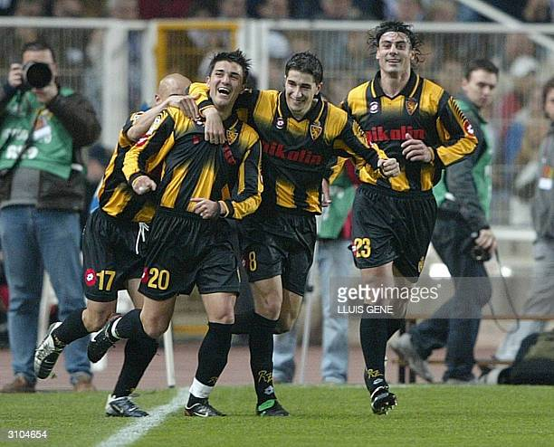 Zaragoza's players David Villa , Cani , Dani Garcia and Movilla celebrate their second goal against Real Madrid during King Cup football Final at...