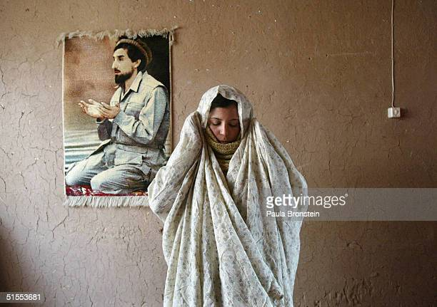 Zarah 19yearsold prays at her mothers home October 22 2004 in Herat Afghanistan She set fire to herself at the climax of an argument with her husband...