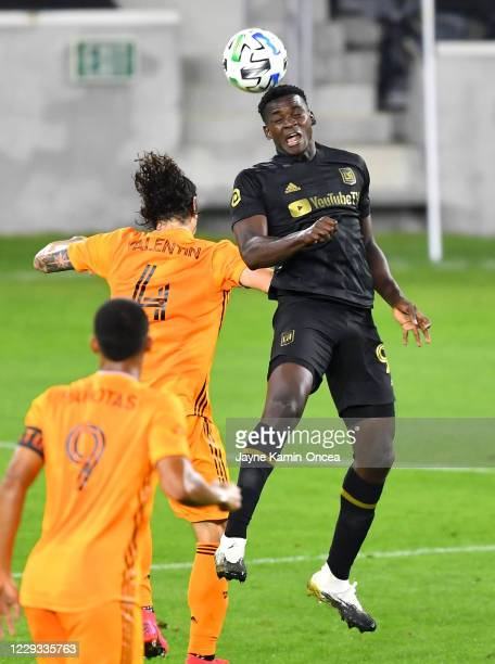 Zarek Valentin of Houston Dynamo defends Jesus Murillo of Los Angeles FC as he heads the ball in the second half of the game at Banc of California...