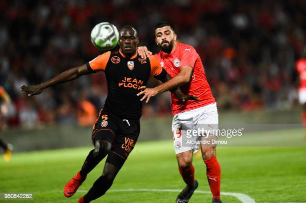 Zargo Toure of Lorient and Umut Bozok of Nimes during the French Ligue 2 match between Nimes and Lorient at Stade des Costieres on April 24 2018 in...