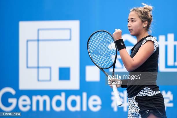 Zarina Diyas of Kazakhstan celebrates a point during the match against Garbine Muguruza of Spain on Day 5 of 2020 WTA Shenzhen Open at Shenzhen...