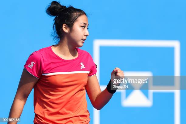 Zarina Diyas of Kazakhstan celebrates a point during the match against Shuai Zhang of China during Day 3 of 2018 WTA Shenzhen Open at Longgang...