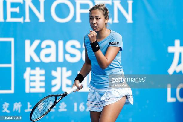 Zarina Diyas of Kazakhstan celebrates a point during the women's singles 1st round match against Duan Yingying of China on day 3 of the 2020 WTA...