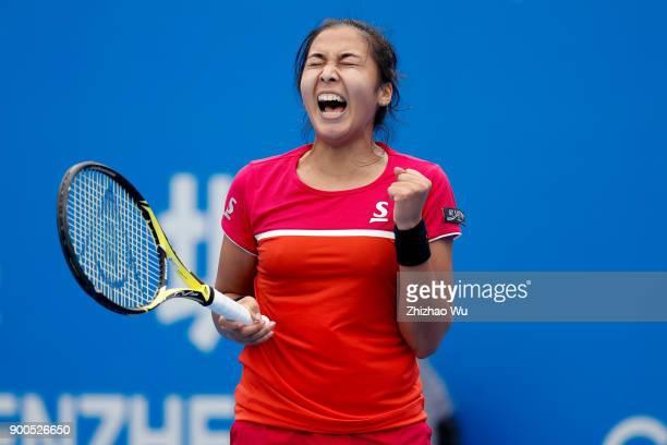 Zarina Diyas of Kazakhstan celebrates during the match against Shuai Zhang of China during Day 3 of 2018 WTA Shenzhen Open at Longgang International...