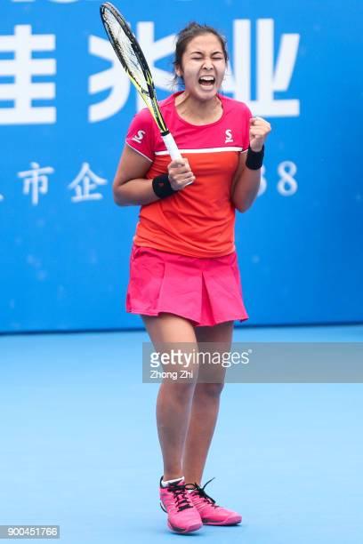 Zarina Diyas of Kazakhstan celebrates winning the match against Shuai Zhang of China during Day 3 of 2018 WTA Shenzhen Open at Longgang International...