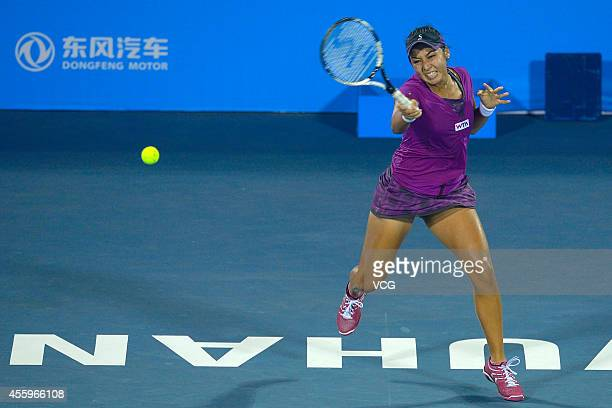 Zarina Diyas of Kazakhstan competes with Angelique Kerber of Germany during day three of the 2014 Dongfeng Motor Wuhan Open at Optics Valley...