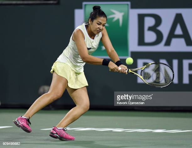 Zarina Diyas of Kazakhstan follows through on her backhand against Serena Williams during Day 4 of the BNP Paribas Open on March 8 2018 in Indian...