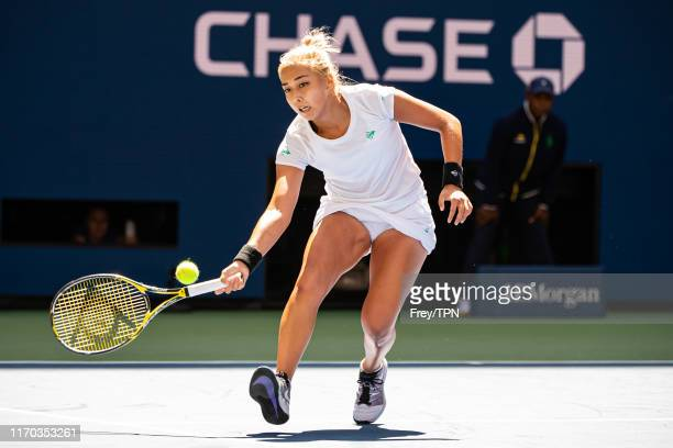 Zarina Diyas of Kazakhstan hits a forehand against Ashleigh Barty of Australia on Arthur Ashe Stadium in the first round of the US Open at the USTA...
