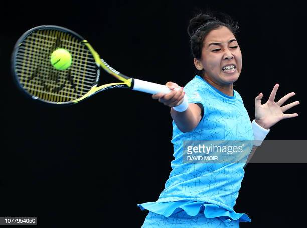 Zarina Diyas of Kazakhstan hits a return against Barbora Strycova of the Czech Republic during their women's first round match at the Sydney...