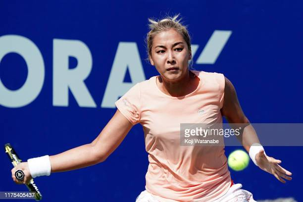 Zarina Diyas of Kazakhstan hits a return shot against Madison Keys of the United States during day three of the Toray Pan Pacific Open at Utsubo...